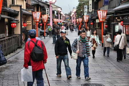 KYOTO, JAPAN - APRIL 16: Tourists walk on April 16, 2012 in Kyoto, Japan. Old Kyoto is a UNESCO World Heritage site and was visited by almost 1 million foreign tourists in 2010.