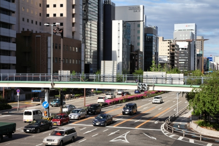 capita: NAGOYA, JAPAN - MAY 3: People drive in heavy traffic on May 3, 2012 in Nagoya, Japan. With 589 vehicles per capita, Japan is among most motorized countries worldwide, which causes heavy traffic.
