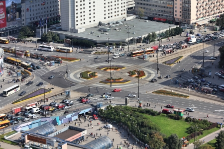 WARSAW - SEPTEMBER 8: People drive in heavy traffic on September 8, 2010 in Warsaw, Poland. Dmowskiego roundabout is the intersection of 2 most important streets in Warsaw.