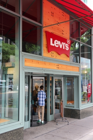 levi: CHICAGO - JUNE 26: Man enters Levis store on June 26, 2013 in Chicago. Levis is an American clothing company. It exists since 1853 and had US$ 4.4bn revenue in 2010. Editorial