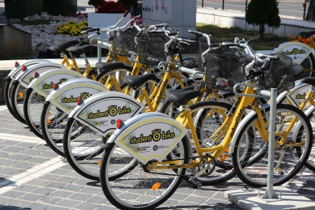 shared sharing: BRASOV, ROMANIA - AUGUST 21: City bikes station on August 21, 2012 in Brasov, Romania. As of 2013 there are 535 bicycle sharing systems in the world with rapidly growing fleet.