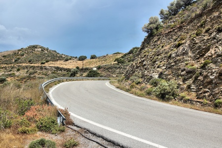 Empty road in rural mountain area of Crete, Greece photo
