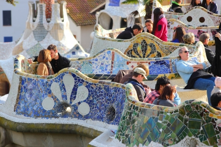 trencadi: BARCELONA, SPAIN - NOVEMBER 6: People visit Park Guell on November 6, 2012 in Barcelona, Spain. It was built in 1900-14 and  is part of the UNESCO World Heritage Site Works of Antoni Gaudi.
