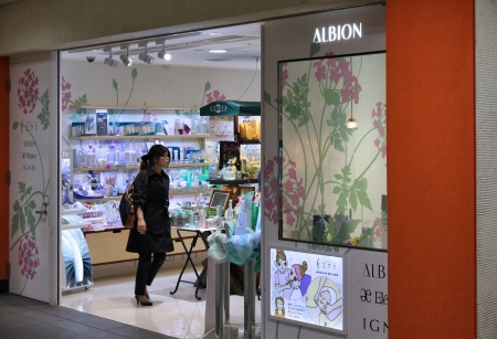exists: TOKYO - APRIL 13: Shopper visits Albion cosmetics store on April 13, 2012 in Tokyo. Albion exists since 1956 and employs 2,950 people as of 2013.