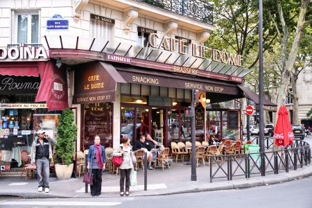 PARIS - JULY 21: People visit Cafe Le Dome on July 21, 2011 in Paris, France. Le Dome cafe is a typical establishment for Paris, one of largest metropolitan areas in Europe.