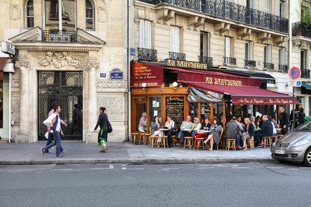 PARIS - JULY 23: People visit Au Savignon cafe on July 23, 2011 in Paris, France. Au Savignon cafe is a typical establishment for Paris, one of largest metropolitan areas in Europe.