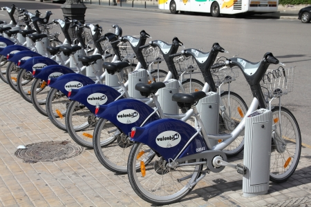 shared sharing: VALENCIA, SPAIN - OCTOBER 10: Valenbisi bike sharing station on October 10, 2010 in Valencia, Spain. With 275 stations and 2,750 bicycles Valenbisi is one of largest bike sharing systems worldwide.