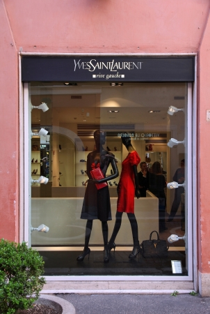 laurent: ROME - APRIL 10: Customers shop at Yves Saint Laurent store on April 10, 2012 in Rome, Italy. YSL is a famous luxury fashion brand founded in 1962. It had 473 million EUR revenue in 2012.