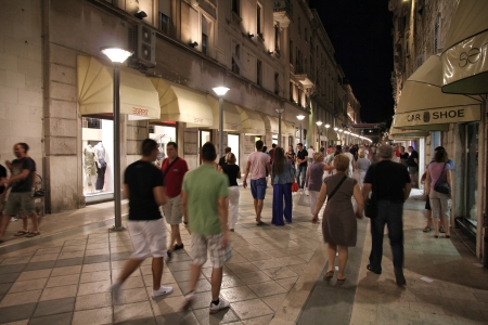 SPLIT, CROATIA - JUNE 27: People walk the old town street in the night on June 27, 2011 in Split, Croatia. In 2011 11.2 million tourists visited Croatia, most of them in summer.
