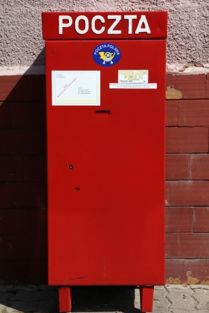 BIALYSTOK, POLAND - AUGUST 12: Polish national post Poczta Polska postbox on August 12, 2011 in Bialystok, Poland. With 93,000 employees, PP is the biggest employer in Poland.