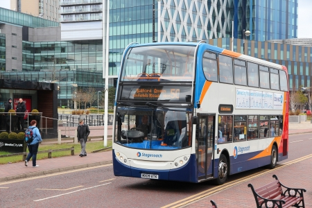 doubledecker: MANCHESTER, UK - APRIL 22: People ride Stagecoach city bus on April 22, 2013 in Manchester, UK. Stagecoach Group has 16% bus market in the UK. Stagecoach UK employs 18,000 people.