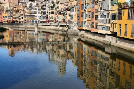 Girona - town in Catalonia, Spain. Onyar River and beautiful, colorful mediterranean architecture. photo