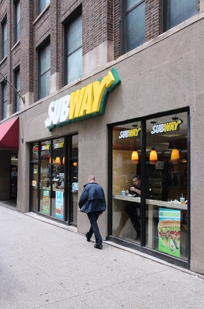 franchises: CHICAGO - JUNE 26: People eat at Subway sandwich store on June 26, 2013 in Chicago. Subway is one of fastest growing restaurant franchises with 39,747 restaurants in 101 countries.