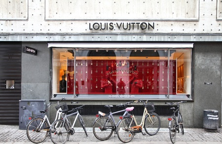 lvmh: COPENHAGEN - MARCH 9: People visit Louis Vuitton store on March 9, 2011 in Copenhagen, Denmark. Forbes says that LV was the most powerful luxury brand in the world in 2008 with $19.4bn USD value.
