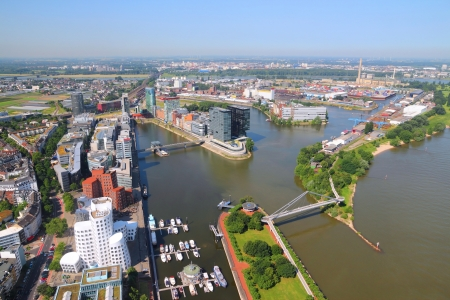 Dusseldorf - city in North Rhine-Westphalia region of Germany. Part of Ruhr region. Aerial view with Hafen (seaport) district on Rhine river.