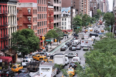 congested: NEW YORK - JULY 3: People drive in heavy traffic along 1st Avenue on July 3, 2013 in New York. New York is among most congested cities in America. In 2009 average American spent 34 hours in traffic jams.