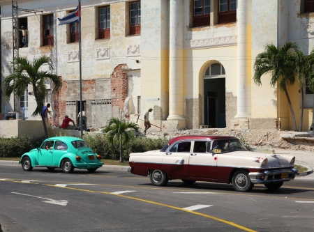 resulted: HAVANA - FEBRUARY 26: People drive old cars on February 26, 2011 in Havana. Recent change in law allows the Cubans to trade cars again. Old law resulted in very old fleet of private owned cars in Cuba. Editorial