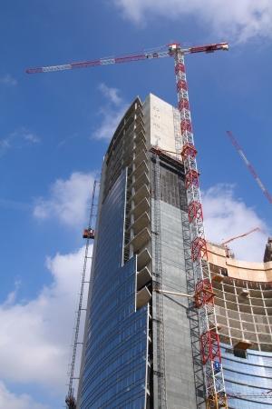 highriser: Generic skyscraper construction in Milan, Italy. Office building development.