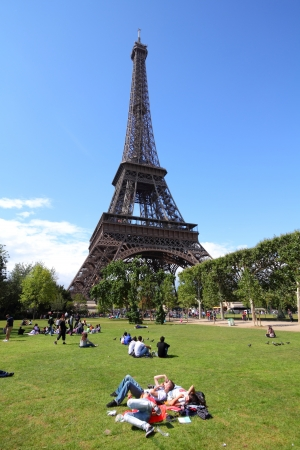 PARIS - JULY 21: People rest in front of Eiffel Tower on July 21, 2011 in Paris, France. Eiffel Tower was the tallest building in the world from 1889 to 1930. It is a major landmark in Paris.