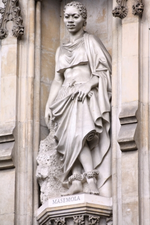 martyr: London, United Kingdom - famous Westminster Abbey church detail. Statue of Manche Masemola, Anglican saint and Christian martyr.  Stock Photo