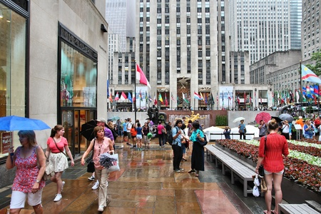 NEW YORK - JULY 1: People visit Rockefeller Center on July 1, 2013 in New York. Rockefeller Center is one of most recognized landmarks in the United States and is a National Historic Landmark.