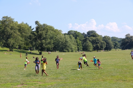 NEW YORK - JULY 6: Young people enjoy sunny day in Prospect Park on July 6, 2013 in Brooklyn, New York. The famous public park dates back to 1867 and has an area of 585 acres. Editorial