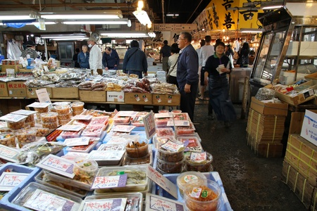 TOKYO - MAY 11: People visit famous Tsukiji Fish Market on May 11, 2012 in Tokyo. It is the biggest wholesale fish and seafood market in the world.
