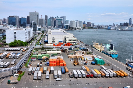 handled: TOKYO - MAY 11: Containers in Port of Tokyo on May 11, 2012 in Tokyo. Port of Tokyo is one of busiest seaports in the Pacific Ocean basin with 100 million tonnes of cargo handled annually. Editorial