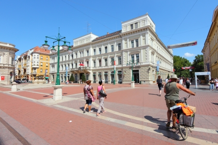 szeged: SZEGED, HUNGARY - AUGUST 13: People stroll on August 12, 2013 in Szeged, Hungary. Szeged is 3rd largest city in Hungary. Tourism in Hungary is growing, with more than 20 million guest nights in 2011.