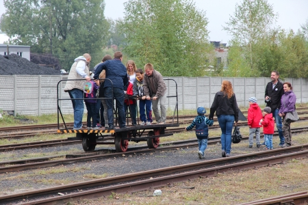 narrowgauge: BYTOM, POLAND - SEPTEMBER 21: People ride narrow gauge draisine on September 21, 2013 in Bytom, Poland. In September 2013 regional narrow gauge celebrated 160th anniversary. Editorial
