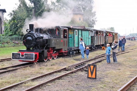 narrow gauge: BYTOM, POLAND - SEPTEMBER 21: People ride old narrow gauge steam train on September 21, 2013 in Bytom, Poland. In September 2013 regional narrow gauge celebrated 160th anniversary.