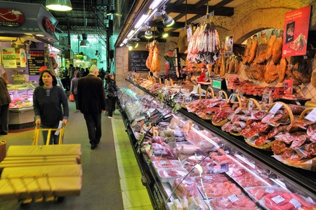 BARCELONA, SPAIN - NOVEMBER 6: People visit Boqueria market on November 6, 2012 in Barcelona, Spain. Tripadvisor says it is best shopping destination in Barcelona, the most visited city in Spain.