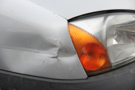 bumps: Small generic car with dented front wing. Minor accident result - fender bender. Stock Photo