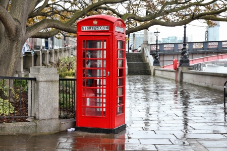 London, United Kingdom - red telephone box in the rain. HDR image. photo