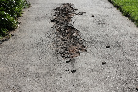 Damaged road in Sofia, Bulgaria. Bad road contitions. photo