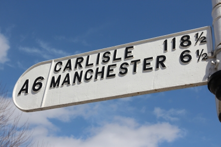 a6: Road sign in England: A6 road to Carlisle and Manchester. Distances in miles.