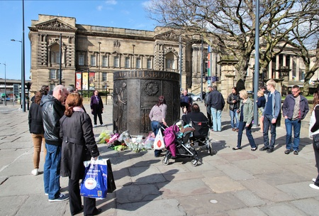 resulted: LIVERPOOL, UK - APRIL 20: People visit Hillsborough disaster memorial on April 20, 2013 in Liverpool, UK. Hillsborough disaster was a stadium crush on April 15, 1989 which resulted in 96 deaths.
