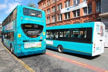enviro: LIVERPOOL, UK - APRIL 20: People ride buses on April 20, 2013 in Liverpool, UK. Liverpool City Region has a population of around 1.6 million people and is one of largest urban areas in the UK. Editorial
