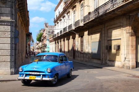 resulted: HAVANA - FEBRUARY 27: People ride Classic American car on February 27, 2011 in Havana. Recent change in law allows the Cubans to trade cars again. Old law resulted in very old fleet of private owned cars in Cuba.