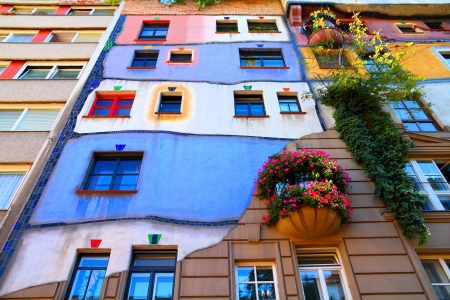 expressionist: VIENNA - SEPTEMBER 6: Hundertwasser Haus on September 6, 2011 in Vienna. The iconic building was finished in 1985 and is one of finest examples of expressionist architecture.
