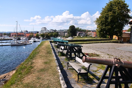kristiansand: Kristiansand, Norway. Capital of Vest-Agder county. Cannons at the coastal fort. Stock Photo
