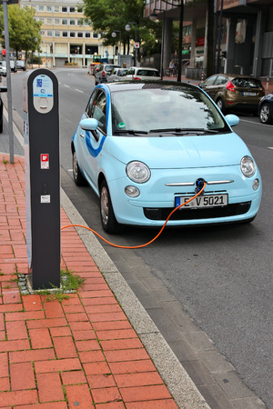 DORTMUND, GERMANY - JULY 15: Electric car is being charged on July 15, 2012 in Dortmund, Germany. Germany announced it aims to have 1 million electric cars on roads by 2020. Sajtókép