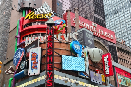 reese's: NEW YORK - JULY 3: Famous Hersheys ad at Times Square on July 3, 2013 in New York. Hershey Company is a chocolate manufacturer founded in 1894. It employs 13,700 people (2010).