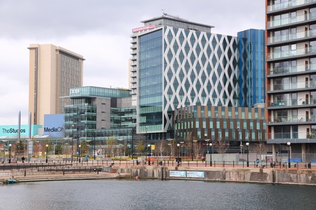 MANCHESTER, UK - APRIL 22: People visit MediaCityUK on April 22, 2013 in Manchester, UK. MediaCityUK is a 200-acre development completed in 2011, used by BBC, ITV and other companies.