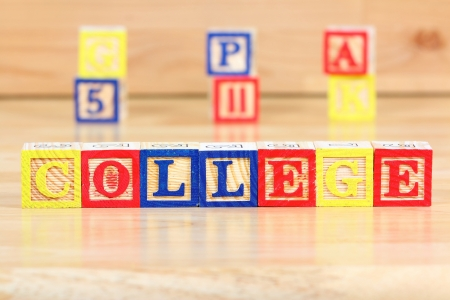 Wooden blocks with letters. Children educational toy concept - future college thinking. photo