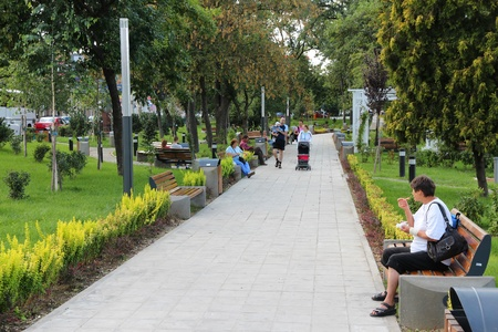 11th century: ARAD, ROMANIA - AUGUST 13: People visit city park on August 13, 2012 in Arad, Romania. Arad is the capital city of Arad County and 12th most populous Romanian city. It dates back to 11th century.