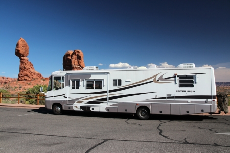 MOAB, UT - JUNE 21: Recreational vehicle parked in Arches National Park on June 21, 2013 in Moab, Utah. Arches NP was visited by 1,070,577 people in 2012.