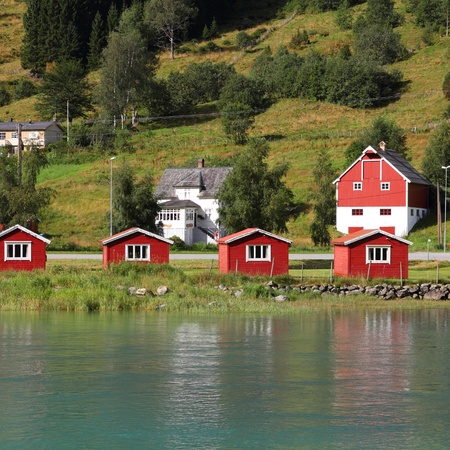 olden: Norway, Sogn of Fjordane county. Small red cabins next to Nordfjord in Olden. Square composition.