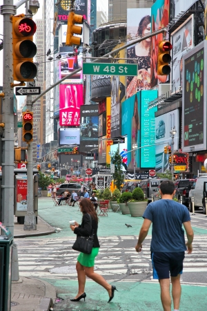 new york times: NEW YORK - JULY 3: People visit Times Square on July 3, 2013 in New York. Times Square is one of most recognized landmarks in the world. More than 300,000 people pass through Times Square daily. Editorial