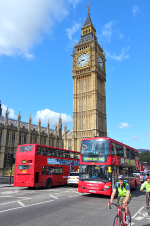 LONDON - MAY 16: People ride buses next to Big Ben on May 16, 2012 in London. With more than 14 million international arrivals in 2009, London is the most visited city in the world (Euromonitor).